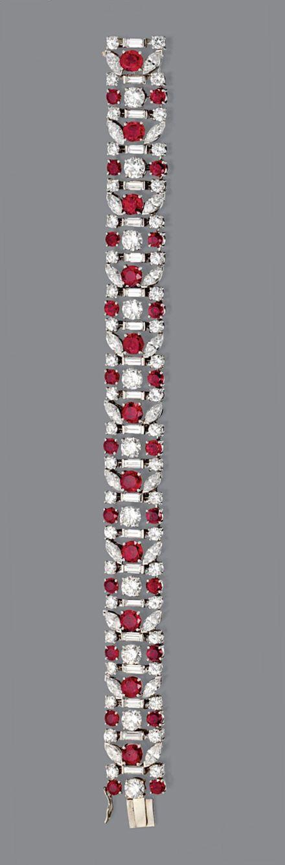RUBY AND DIAMOND BRACELET, TIFFANY & CO., CIRCA 1950. The flexible band deco...
