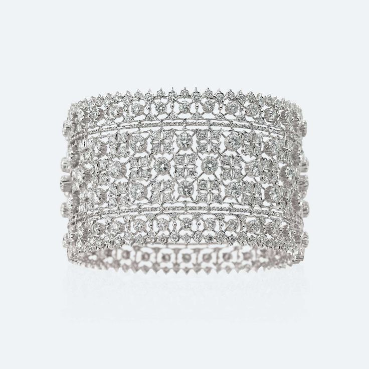 The openwork, light as a lace and brilliant as a roomful of mirrors, features sq...