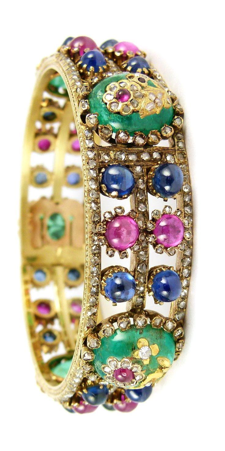 Emerald, ruby, sapphire, diamond and gold bracelet.