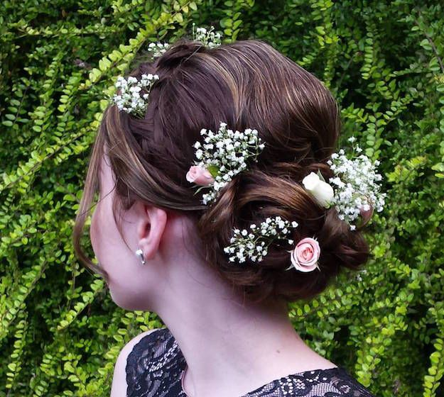 Curly Floral Bun| 12 Curly Homecoming Hairstyles You Can Show Off