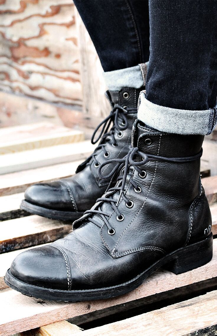 Black leather lace up boot by BEDSTU. This easy on combat boot features a back z...