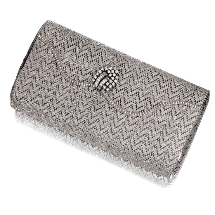 Gold and diamond evening bag - Of rectangular form and chevron design, the scall...