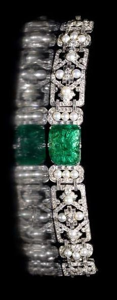 An Art Deco emerald, pearl diamond bracelet, ca 1935. The central oblong emerald...