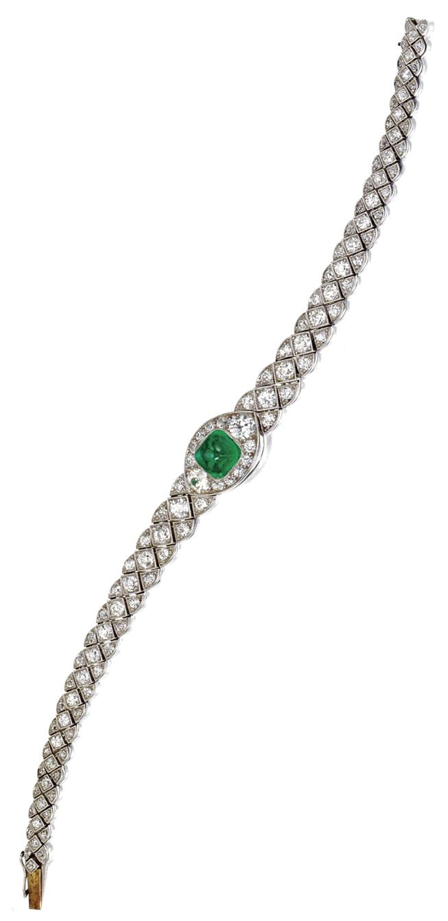 EMERALD AND DIAMOND BRACELET, CIRCA 1920. Designed as a central navette-shaped l...