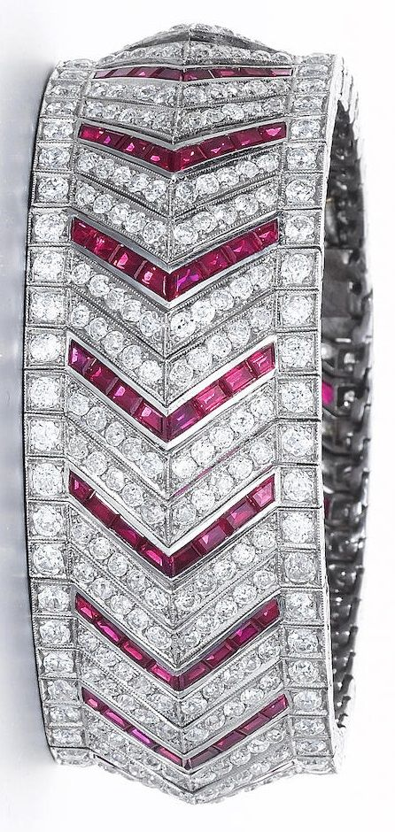 Vever - An Art Deco ruby and diamond bracelet, circa 1925. The wide articulated ...