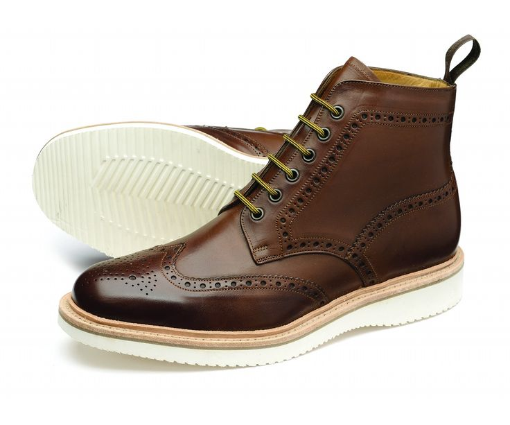 A stylish full brogue boot, 'Maitland' features a lightweight EVA wedge ...