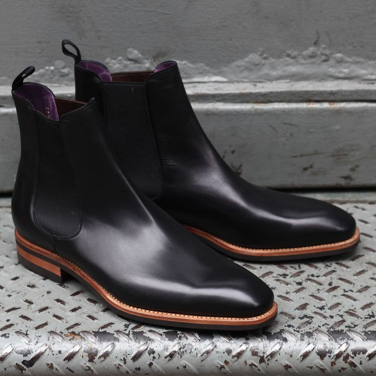 Carmina. I don't really black shoes but I love the accented brown