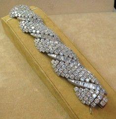A beautiful rare art deco diamond bracelet set with approximately 100 carats of ...