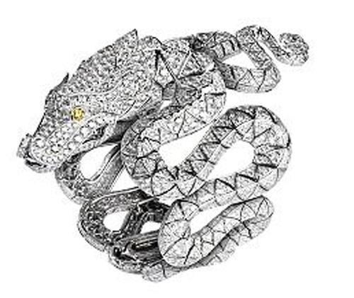 CARTIER DIAMOND,ONYX AND SAPPHIRE DRAGON