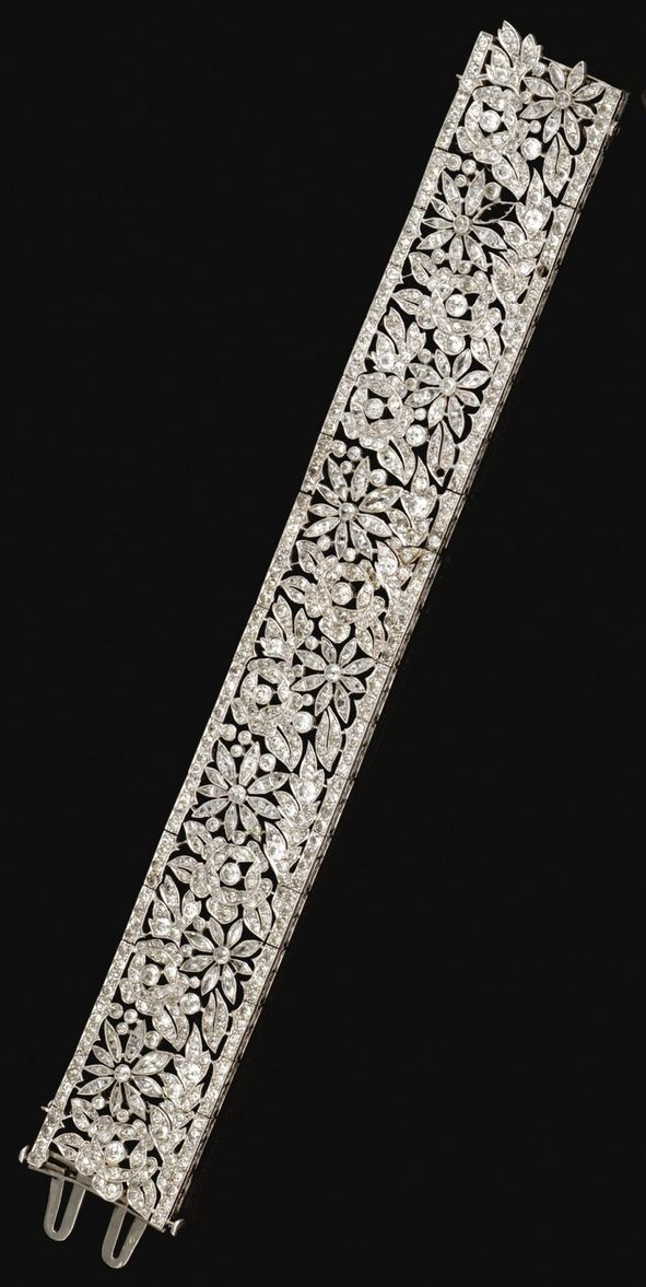 Diamond bracelet, French, circa 1915. The articulated openwork band decorated wi...