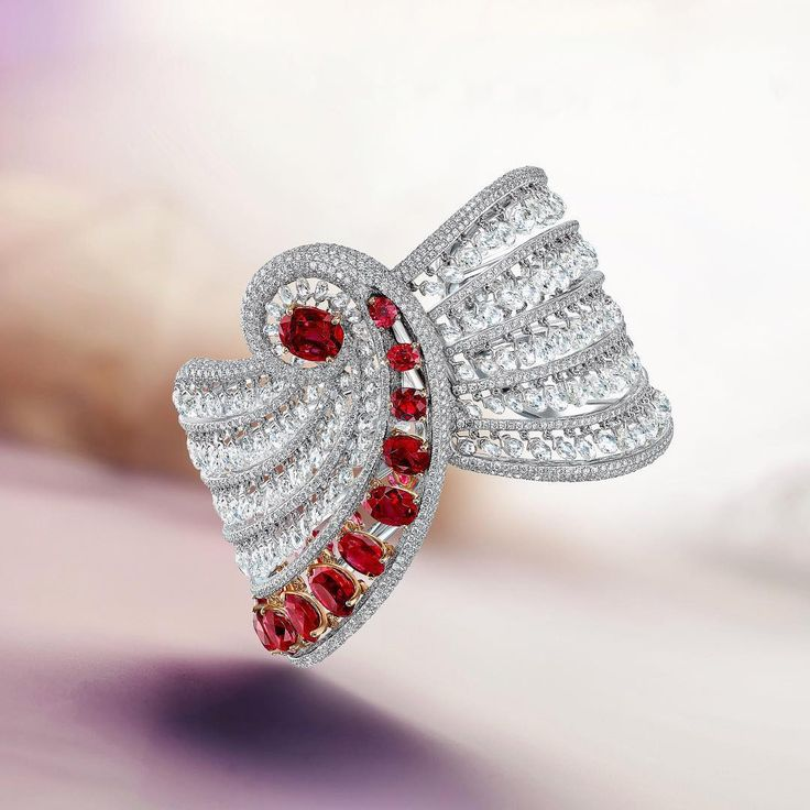 Floating like a drapery, this bracelet's rows of natural Burma rubies and briole...