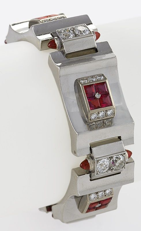 An Art Deco polished platinum, 8 karat gold, diamond and ruby bracelet, French, ...