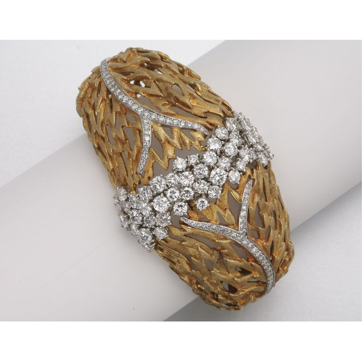 GOLD, PLATINUM AND DIAMOND BRACELET
