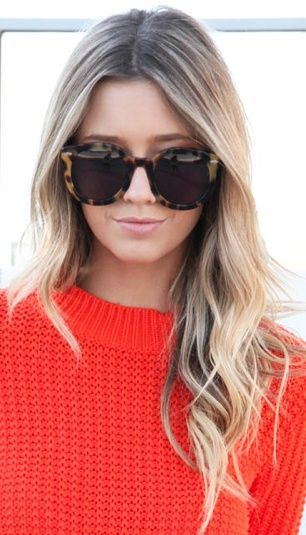 Orange sweater, sunnies, long blonde hair