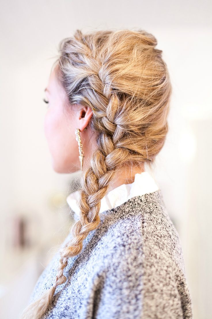 Side braid. Hairdo for women with long hair.