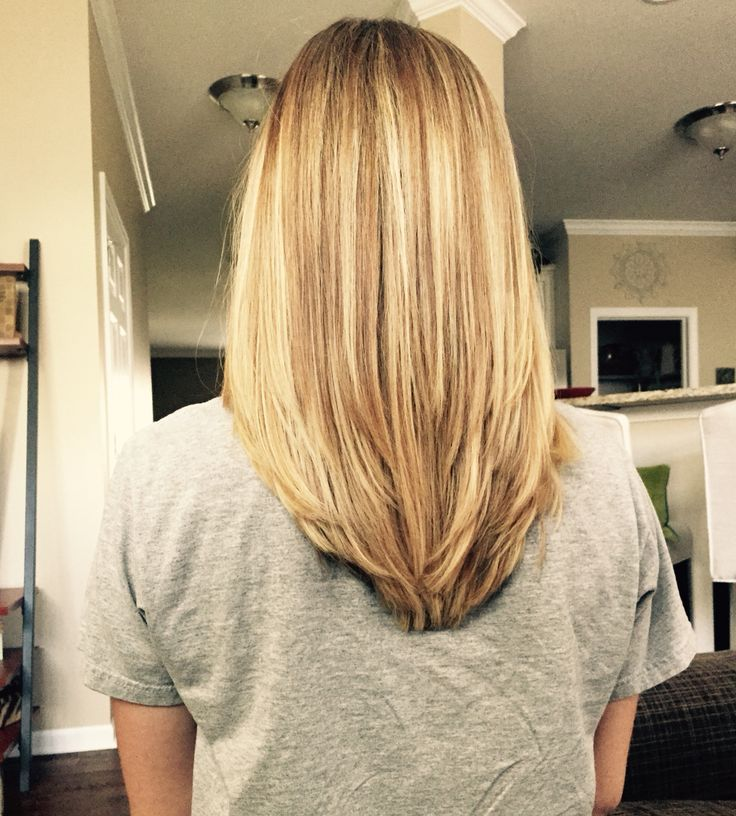 V shape in the back with some long layers! My new hair style. Very good for my t...