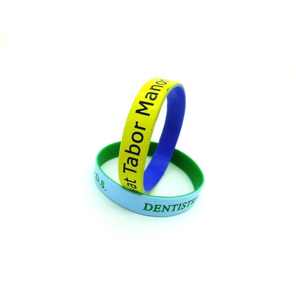 new fashion silicone bracelets with small badges #colorcoatedwristband #silicone...