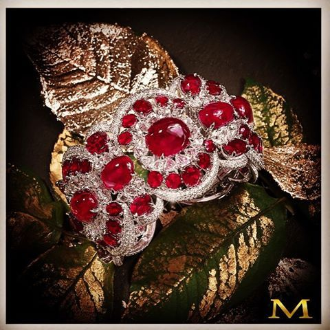 Festive Spirit! A magnificent Moussaieff bangle with the most beautiful Cabochon...