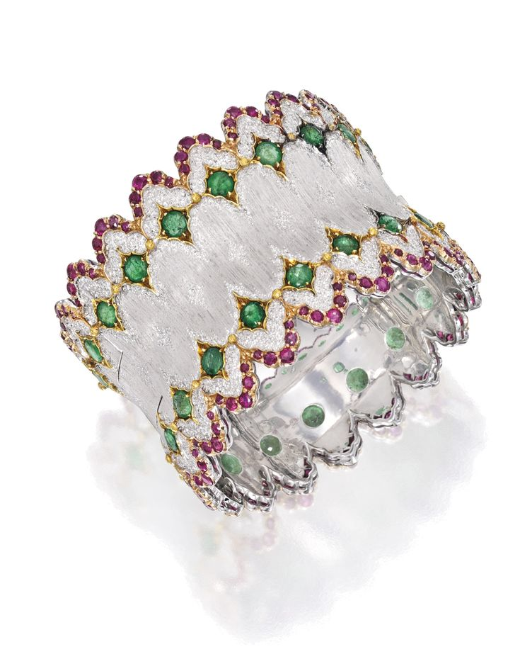 18 KARAT TWO-COLOR GOLD, EMERALD AND RUBY BANGLE-BRACELET, BUCCELLATI. Set with ...