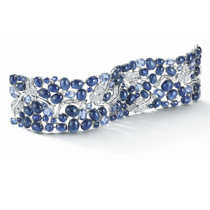 A Vine Bracelet in Sapphire and Diamond set in 18K White Gold. Signed Seaman Sch...