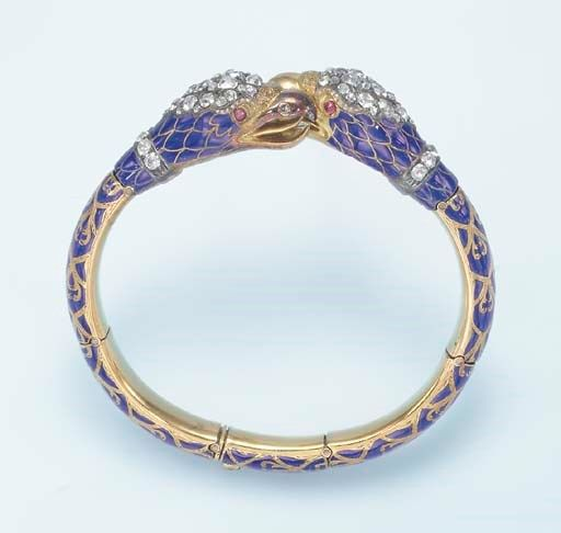 AN ANTIQUE ENAMEL AND DIAMOND BANGLE BRACELET Designed as twin old European-cut ...