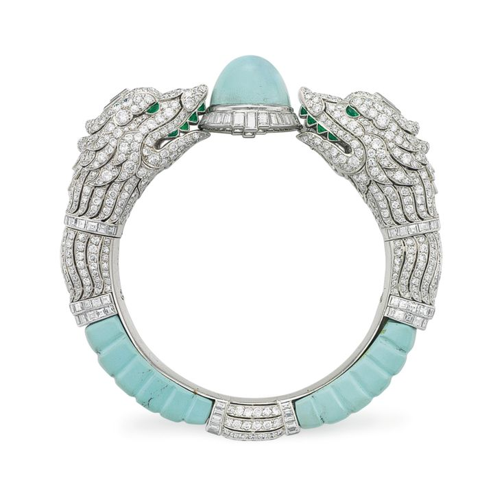 AN ART DECO DIAMOND, TURQUOISE AND EMERALD BANGLE BRACELET