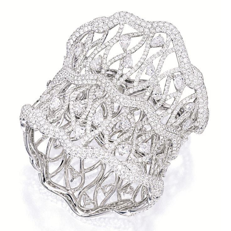 DIAMOND BANGLE The openwork cuff-bangle set with brilliant-cut diamonds, highlig...