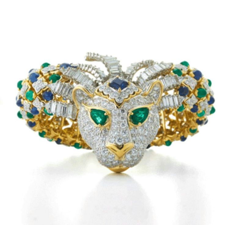 David Webb lion bracelet featuring cabochon and pear-shaped emeralds, cabochon a...