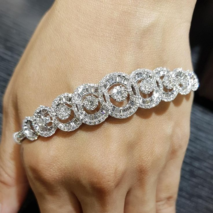 Pair two stunning diamond shapes, round and baguette, for one elegant design whe...