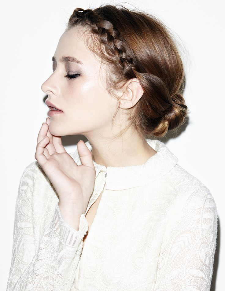 style | low bun with accent braids around crown | via: nylon mag