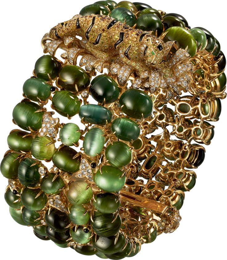 CARTIER. Bracelet - yellow gold, cat's eye tourmalines, onyx, emeralds, orange, ...