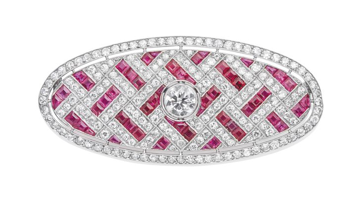 ART DECO RUBY AND DIAMOND BROOCH Calibrés-cut rubies and old-cut diamonds, plat...