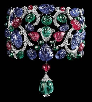 Cartier Tutti Frutti. Platinum, carved emeralds, rubies and sapphires, brilliant...