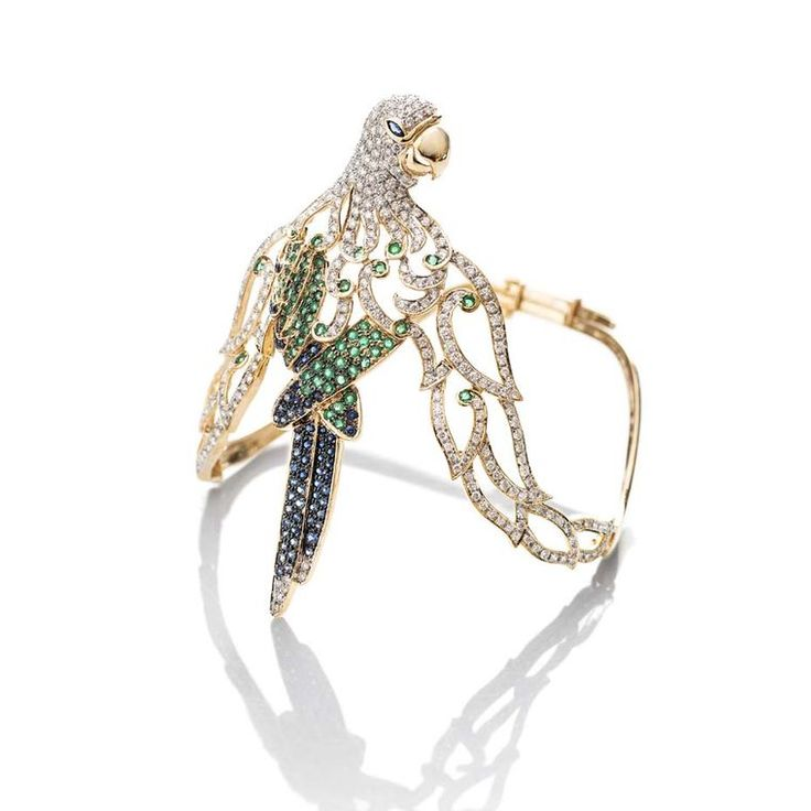 Our kind of #parrot doesn't talk back and is made with #emeralds, #sapphires and...