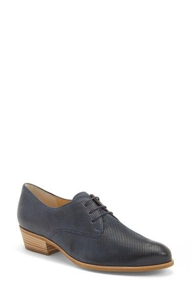 A classic, menswear-inspired oxford is made modern with perforated Italian-leath...