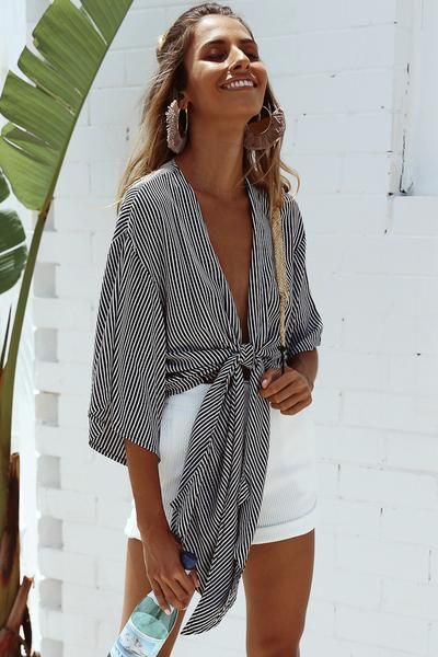 For a simple yet chic vacation look, pair white shorts with a striped tie shirt....