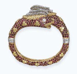 A RUBY, COLOURED DIAMOND AND DIAMOND 'CHIMAERA' BANGLE, BY CARTIER. Designed as ...