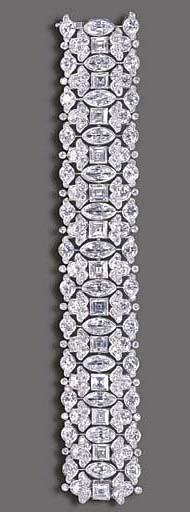 AN ELEGANT DIAMOND BRACELET, BY HARRY WINSTON The highly flexible wide band, com...