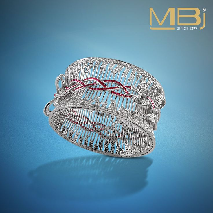 Diamond bracelet with round shaped diamonds and rubies. #diamond #ruby #fashion ...