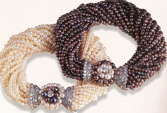 A pair of natural black and white pearl torsade bracelets with pearl and diamond...