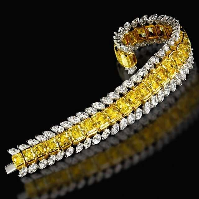 Outstanding 52.57 carat Fancy Yellow and White Diamond Bracelet by #ronaldabram ...