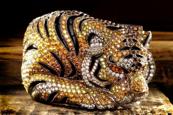 Bracelet - white gold, brown, orange and yellow diamonds, onyx, yellow-orange di...