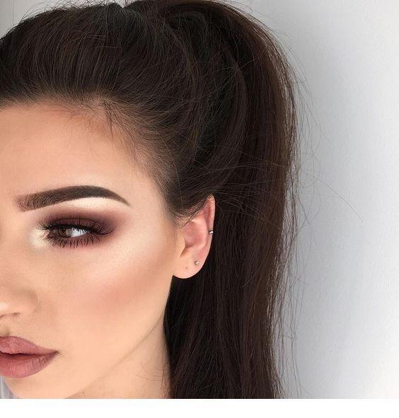 High ponytail and brown makeup