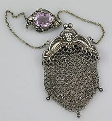 A sterling chain mesh coin purse with a figural frame and three drop beads. It i...