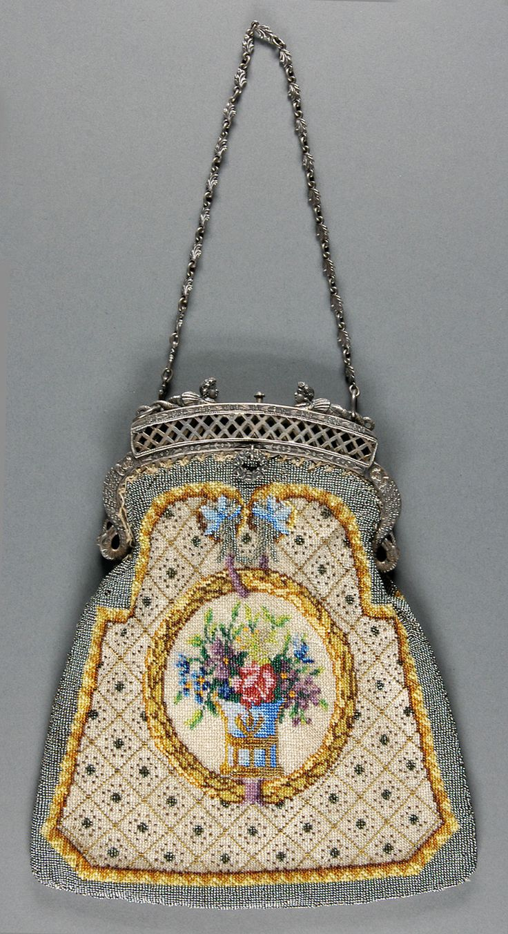 Made in the United States c. 1905 of linen with bead embroidery and silver metal...