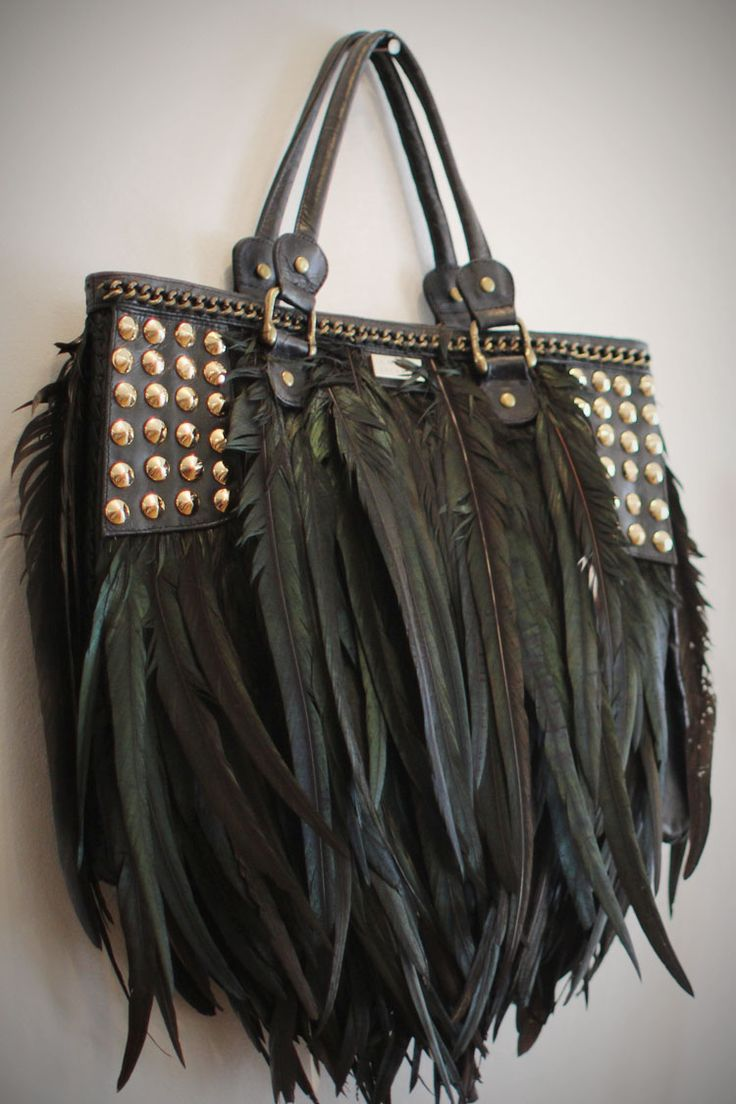 studs and feathers...i would SO break all those feathers the first time i took t...