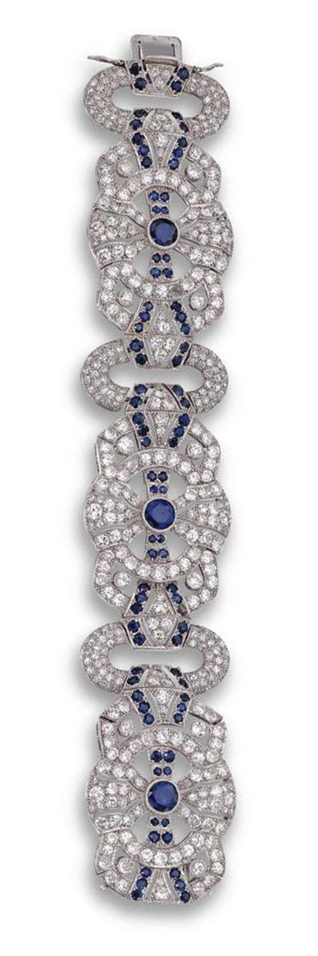 DIAMOND AND SAPPHIRE BRACELET, FRENCH, CIRCA 1930.  Designed as three articulate...