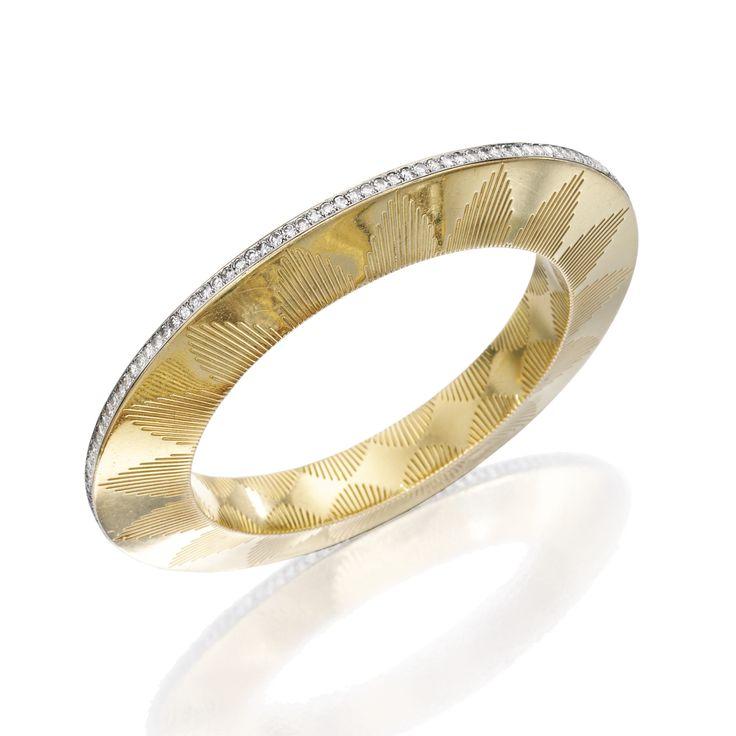 18 KARAT GOLD, PLATINUM AND DIAMOND BANGLE-BRACELET, CARTIER, FRANCE The gold ba...