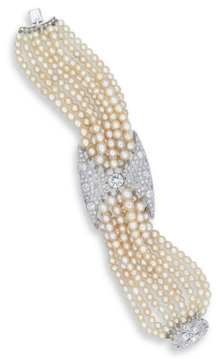 A NATURAL PEARL, PEARL AND DIAMOND BRACELET CENTERING UPON AN OLD EUROPEAN-CUT...