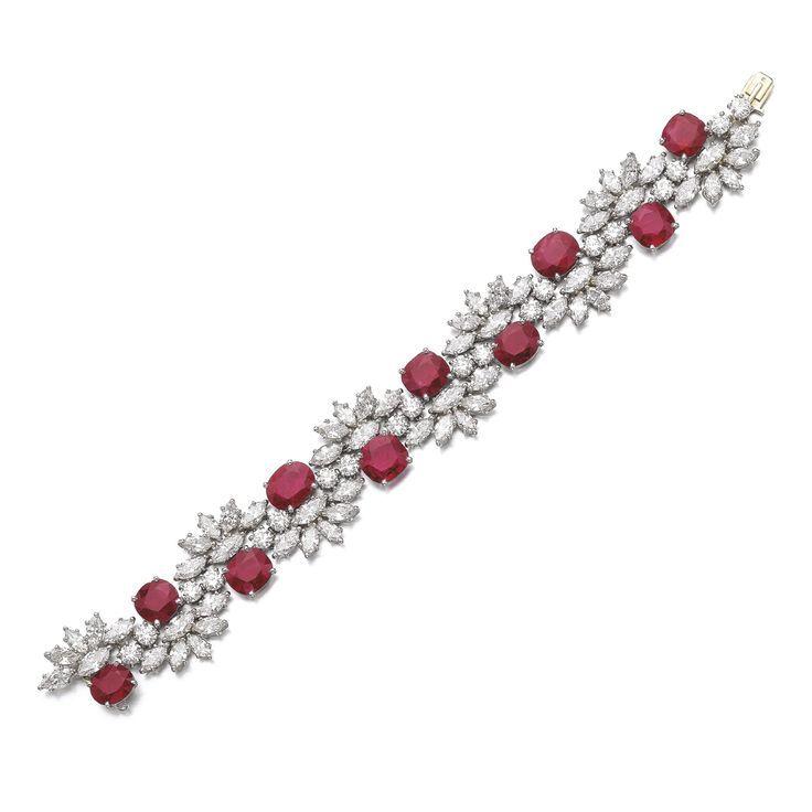 Best Diamond Bracelets : RUBY AND DIAMOND BRACELETSet with oval and cushion-shaped rubies, highlighted wi